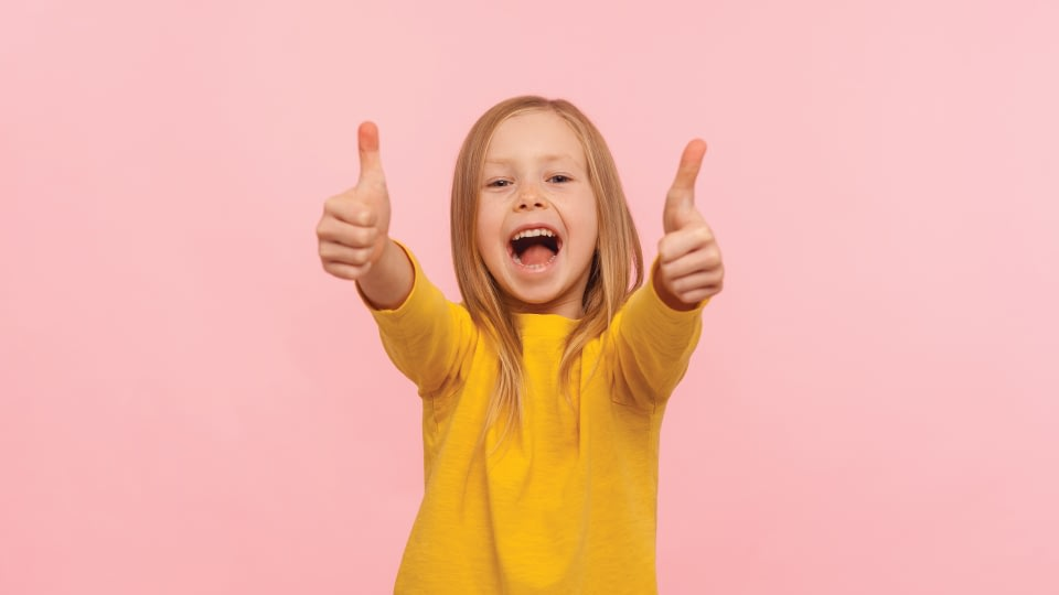 Happy child with thumbs-up